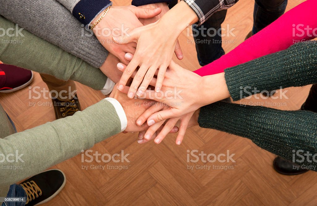 Stack of hands stock photo