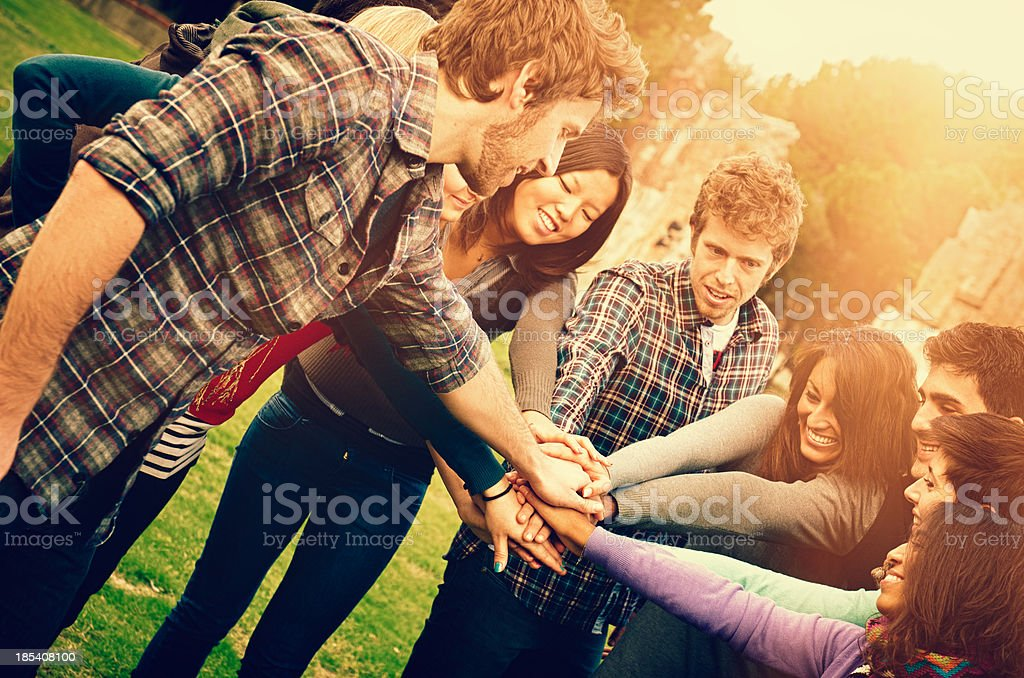 Stack of hands - young friends royalty-free stock photo