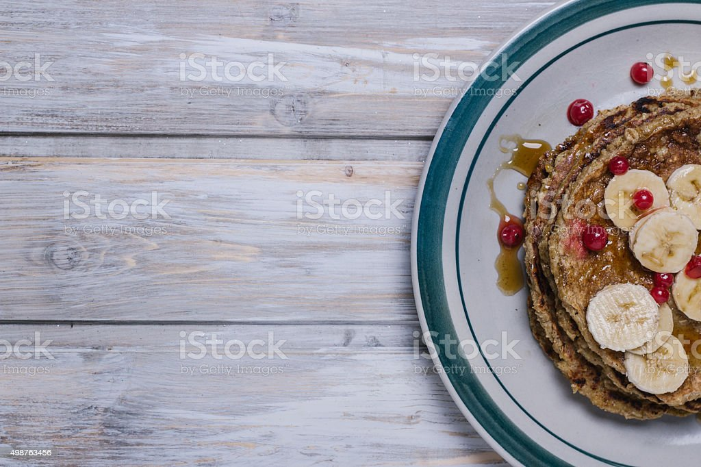 Stack of healthy low carbs oat pancakes taken from above royalty-free stock photo