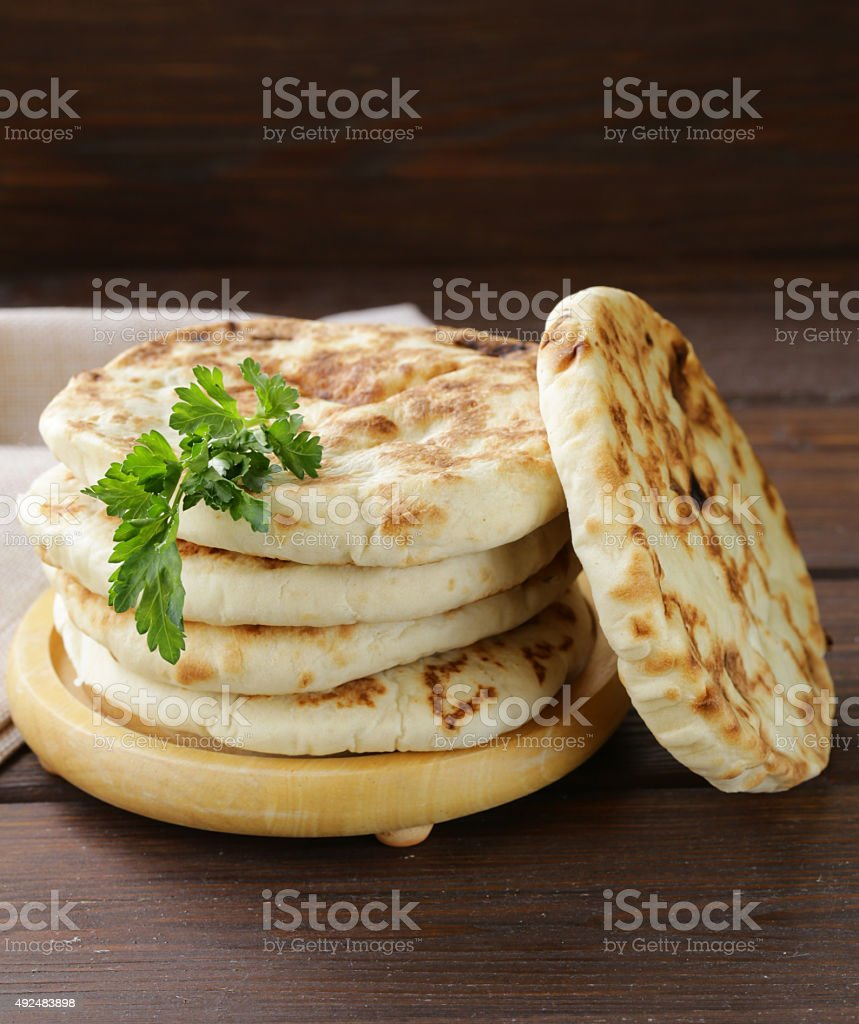 stack of homemade tortillas pita on a wooden table stock photo