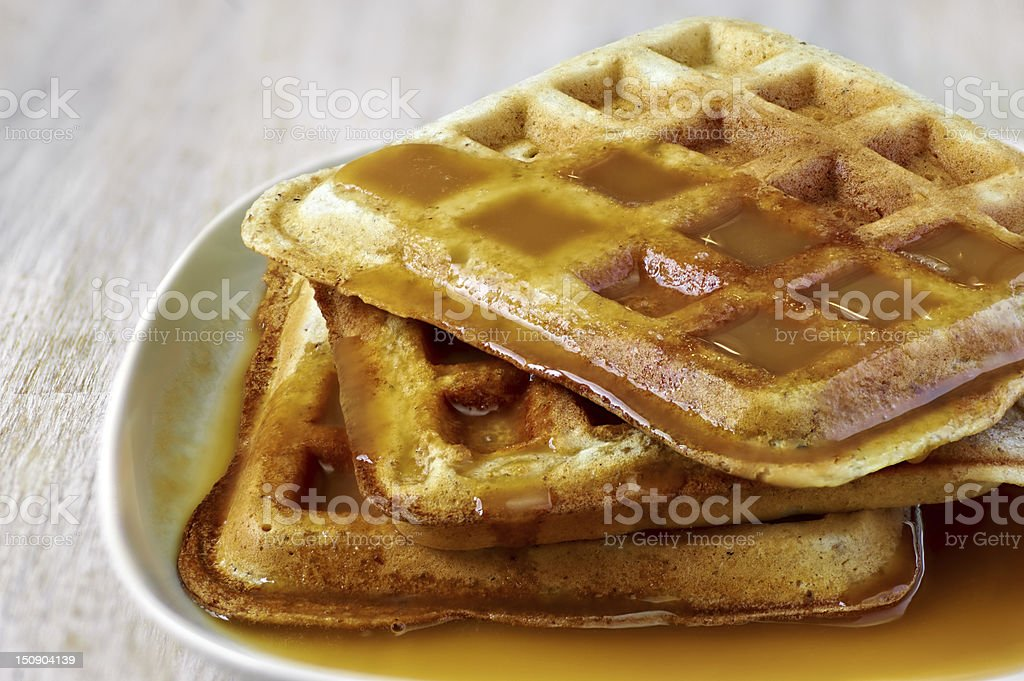 Stack of homemade waffles  with sweet sauce stock photo
