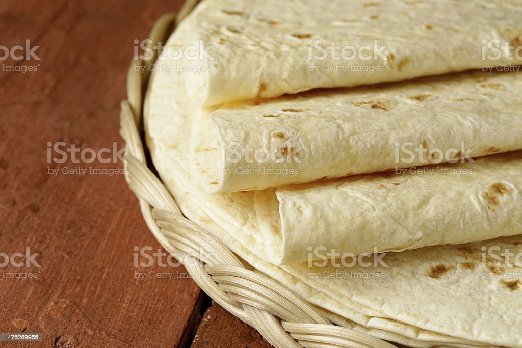 stack of homemade whole wheat flour tortillas stock photo