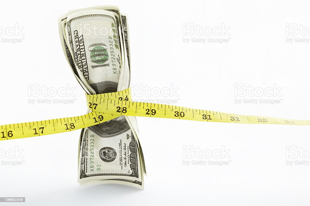 Stack of hundred dollar bills with a tape stock photo