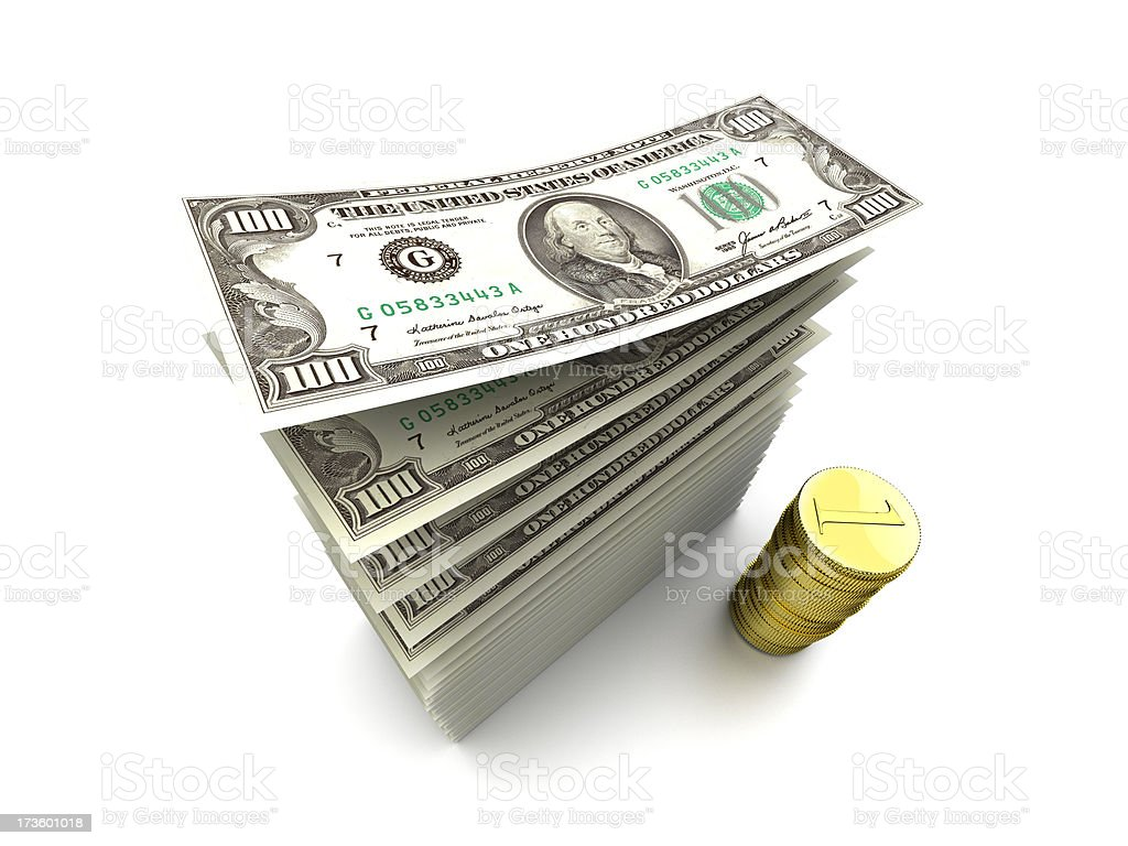 stack of hundreds and gold coins royalty-free stock photo
