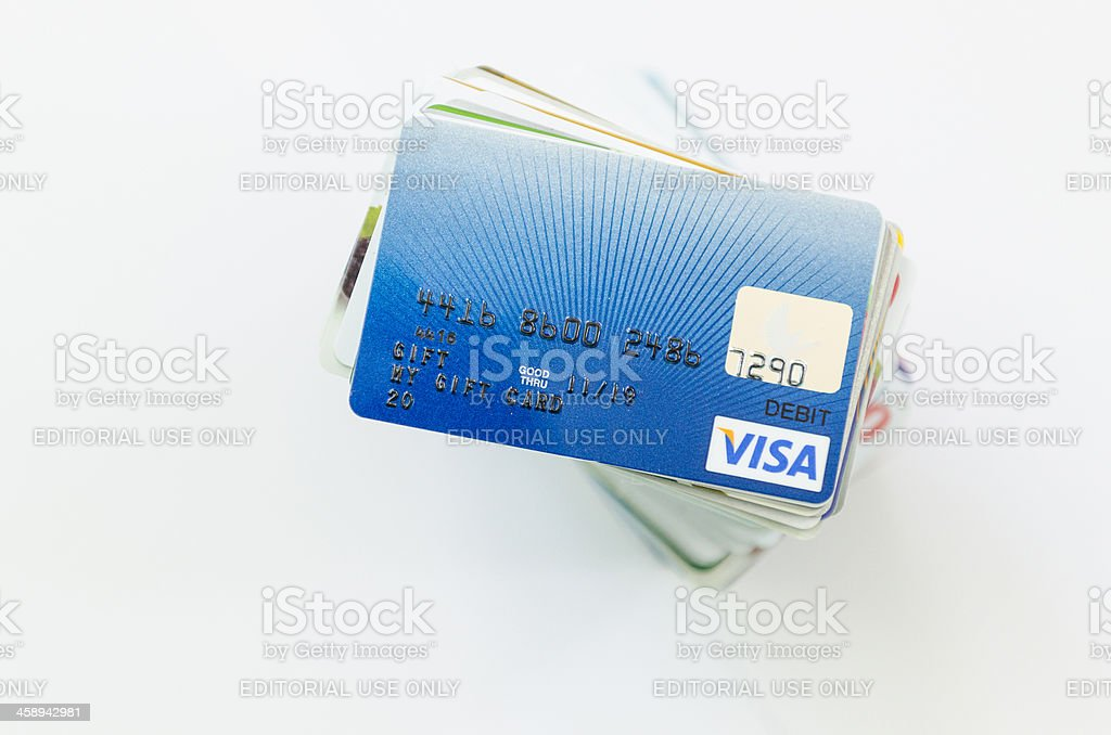stack of hundreds credit cards stock photo