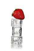 stack of ice cubes with strawberry on top