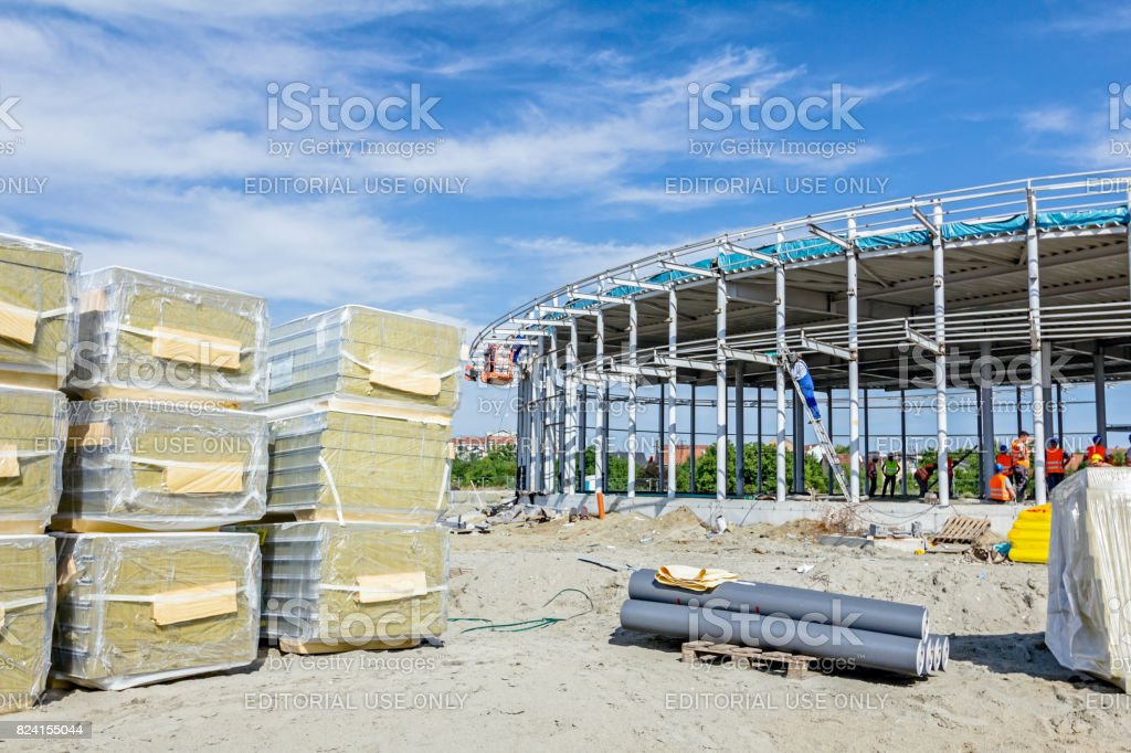Stack of insulation composite panel walls are piled on building site stock photo