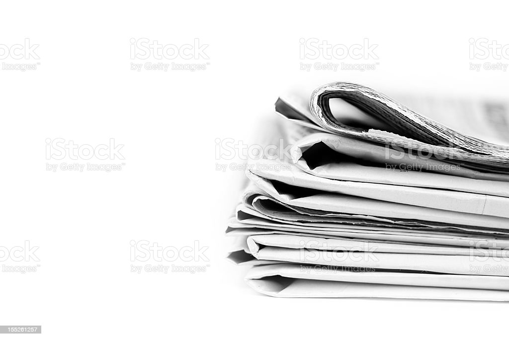 Stack of isolated newspapers in black and white stock photo