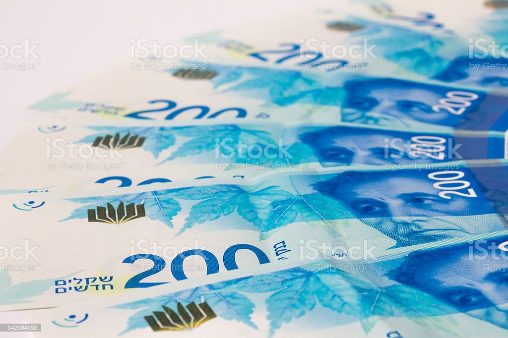 Stack of Israeli money bills of 200 shekel stock photo
