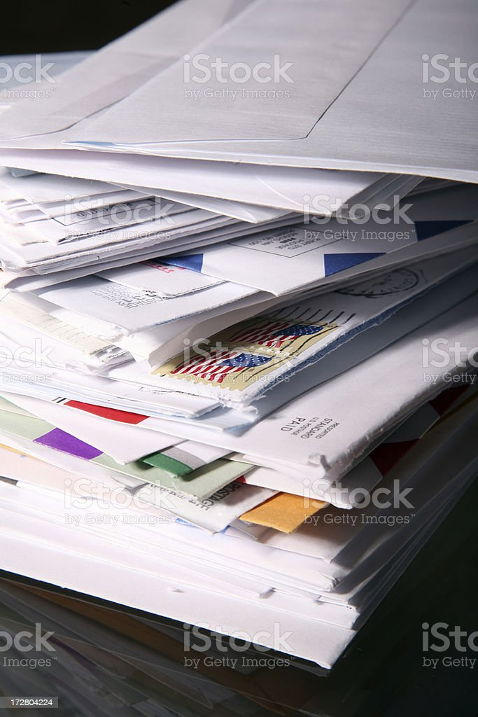 Stack of Junk Mail and Unpaid Bills stock photo