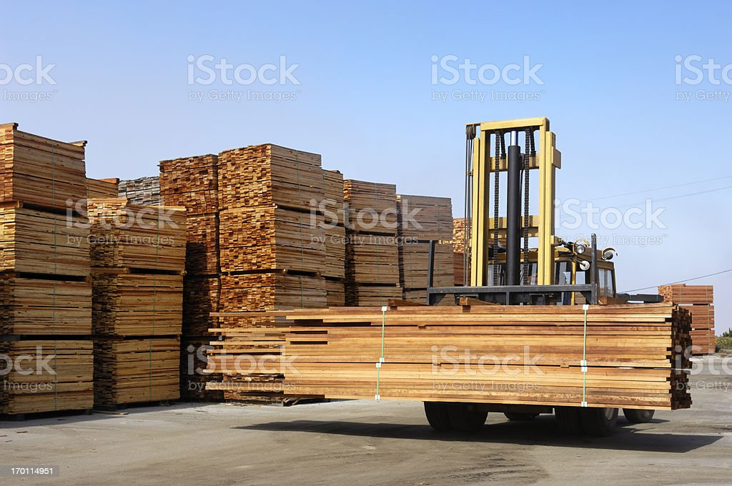 Stack of Just Milled Redwood Lumber Being Moved royalty-free stock photo