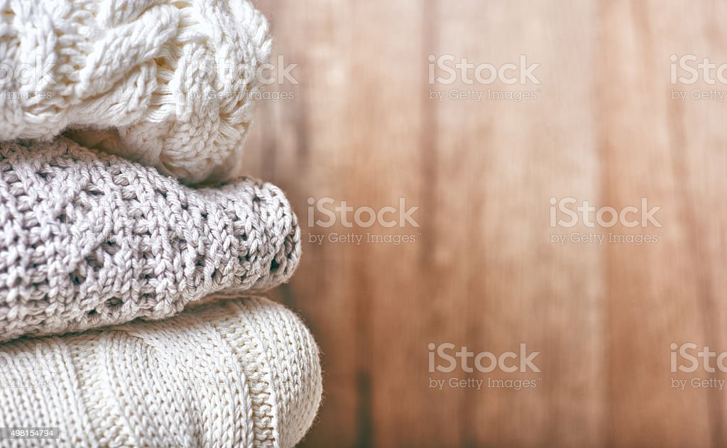 stack of knitting clothes stock photo