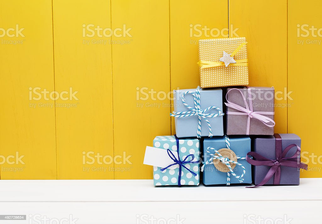 Stack of little present boxes stock photo