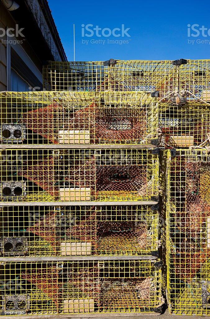 Stack of lobster traps on fishing stock photo