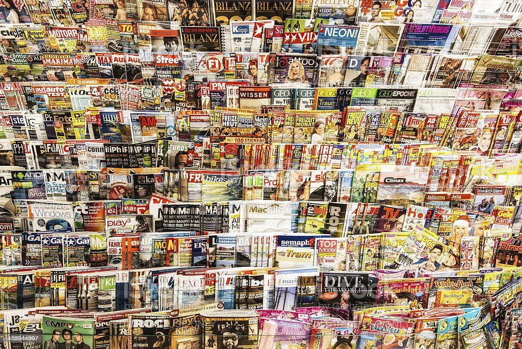 stack of magazines in a kiosk stock photo