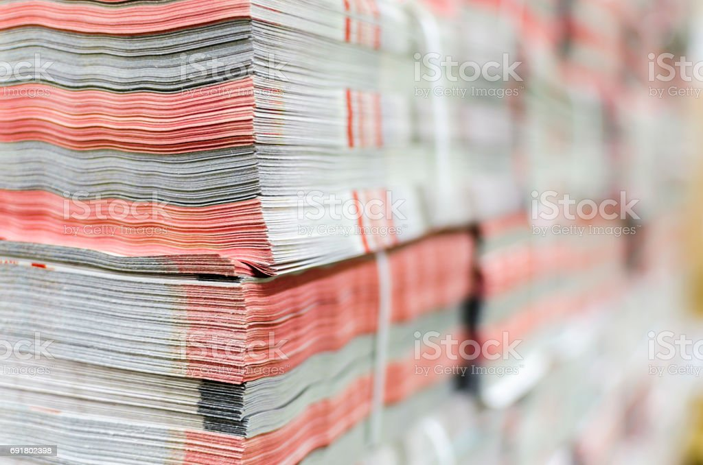 Stack of magazines in print plant ready for delivery. Packaging,...