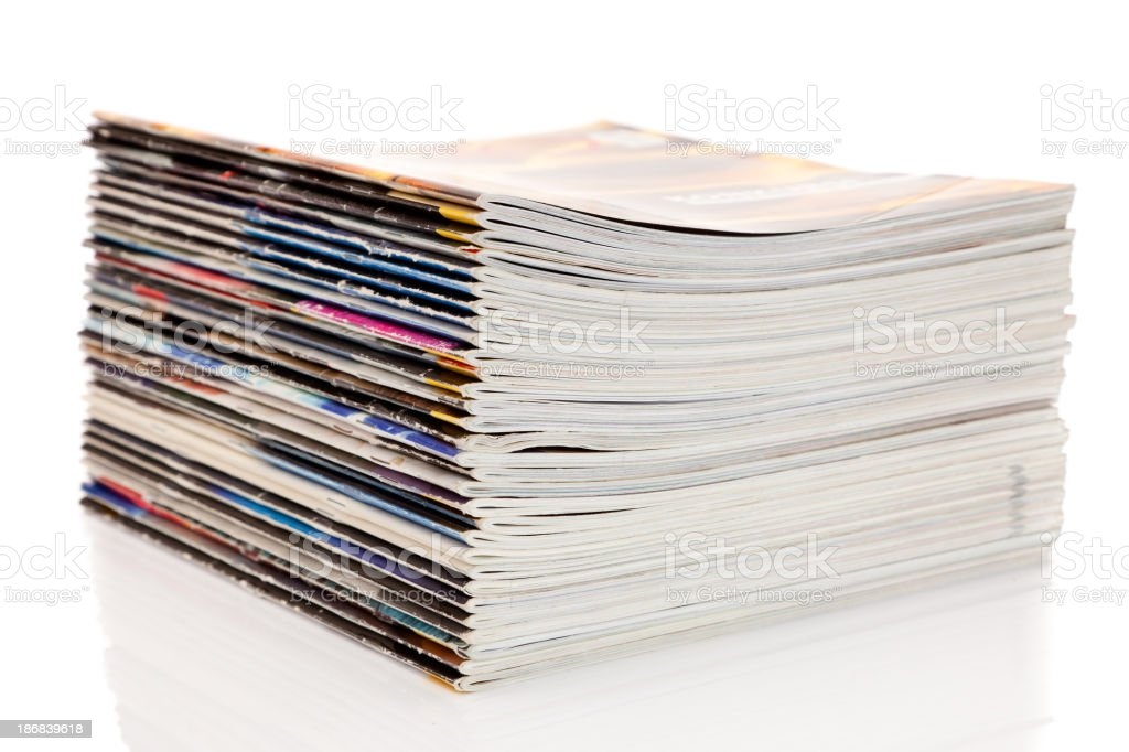 Stack of magazines isolated on a white background royalty-free stock photo