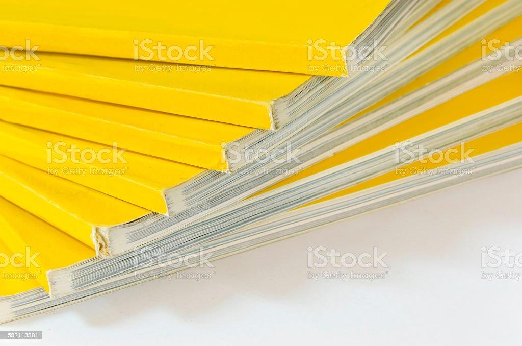 Stack of magazines isolated on white background stock photo