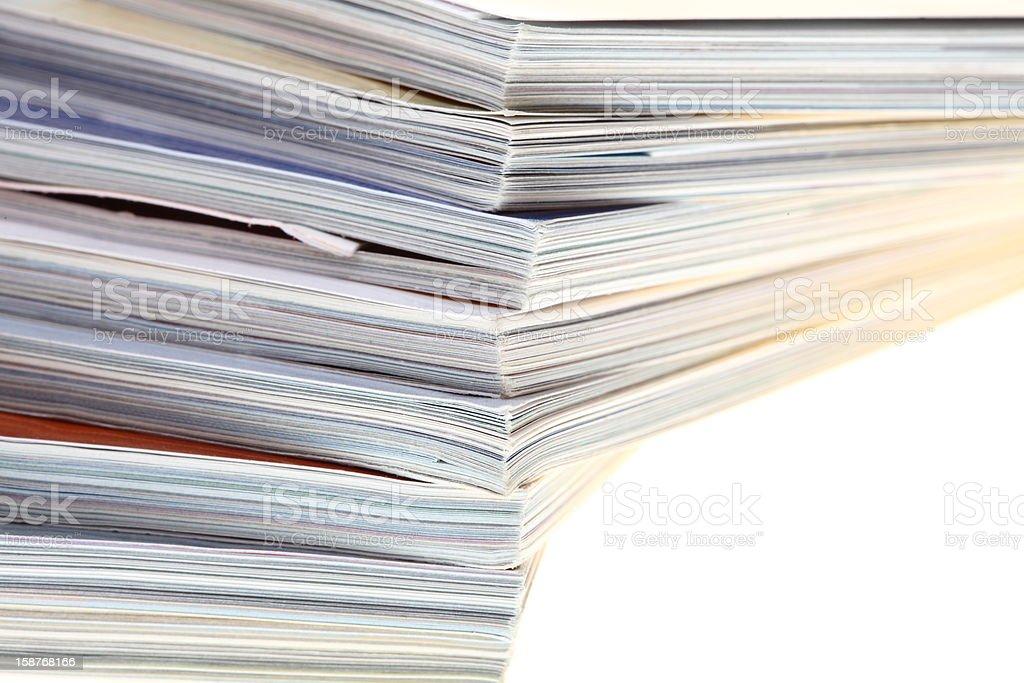 stack of magazines isolated royalty-free stock photo