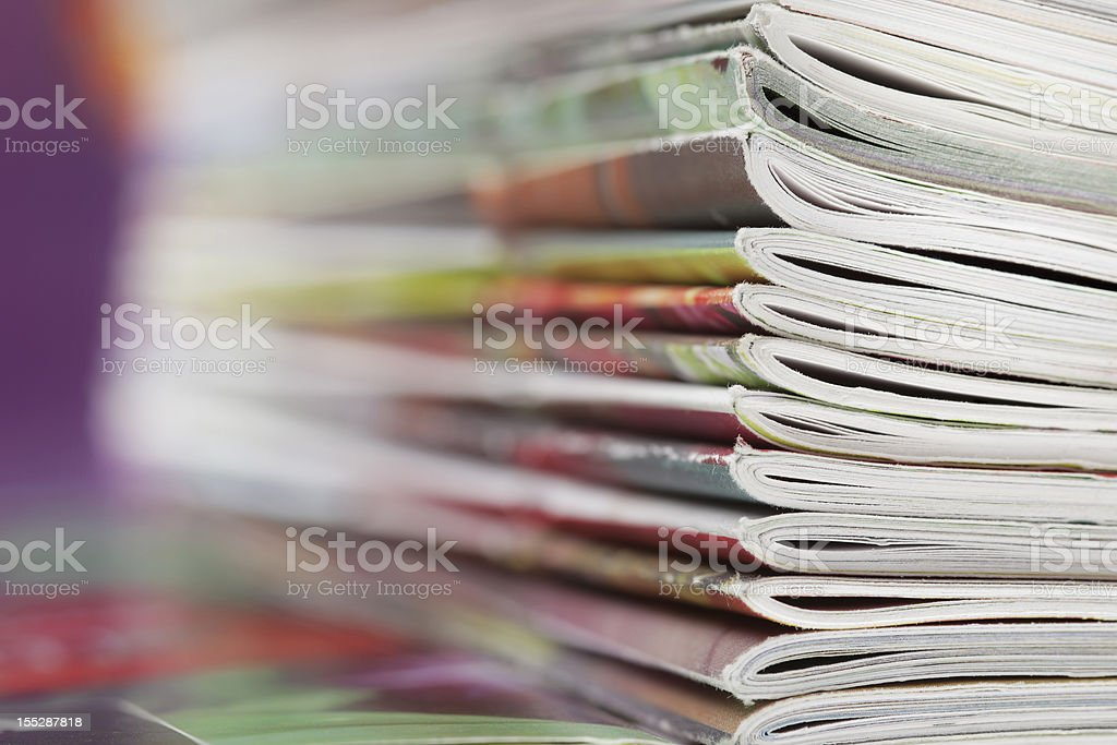Stack of magazines that progressively blurs toward the left stock photo