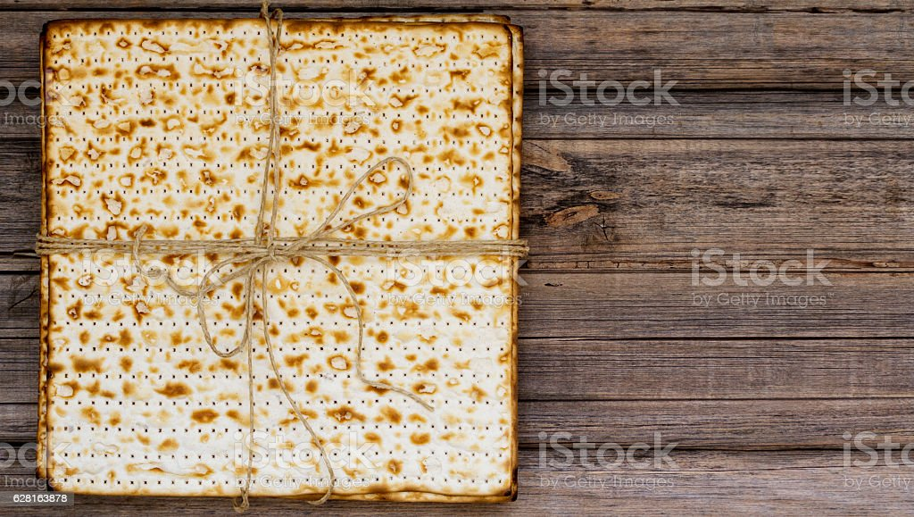 Stack of matzah bread on a vintage wood background stock photo
