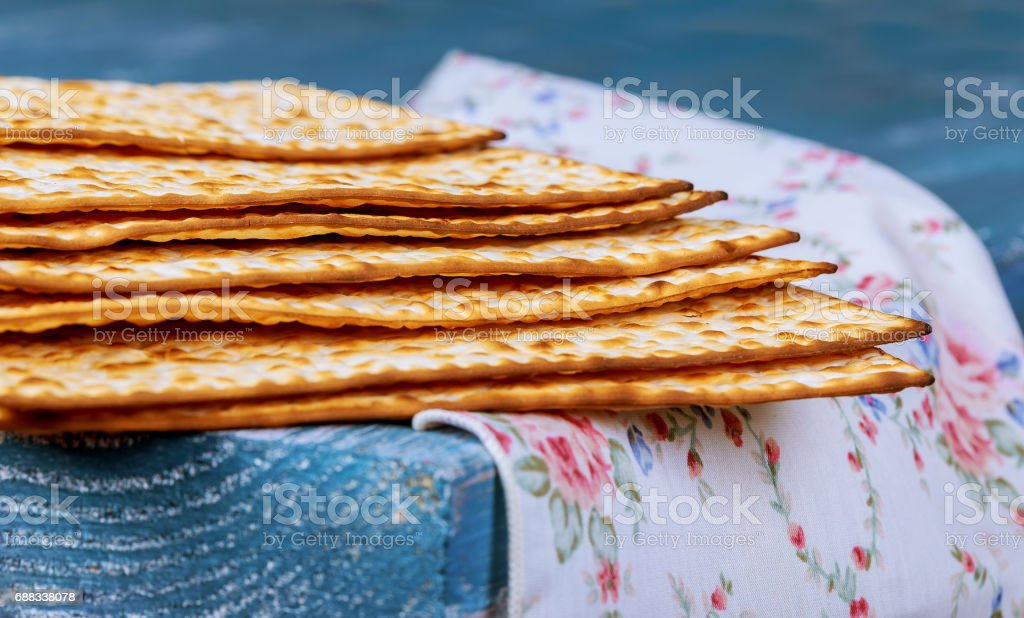 Stack of matzah or matza on a vintage wood background with copy space. stock photo