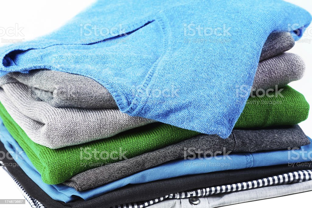 Stack of men clothing on white background royalty-free stock photo