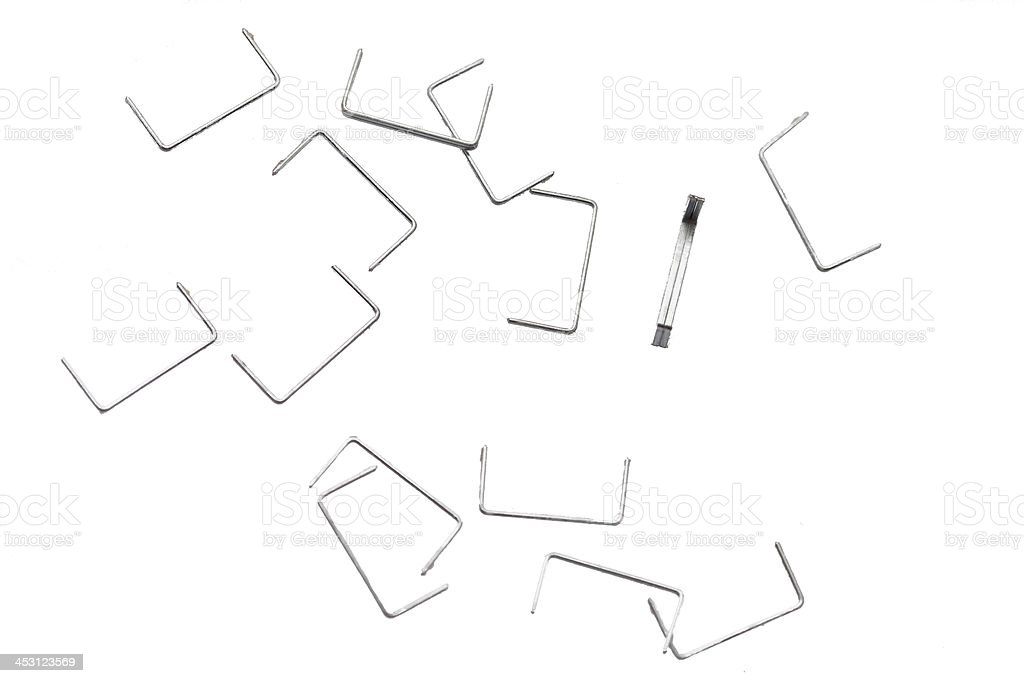 Stack of metal staples. Isolated on a white. royalty-free stock photo