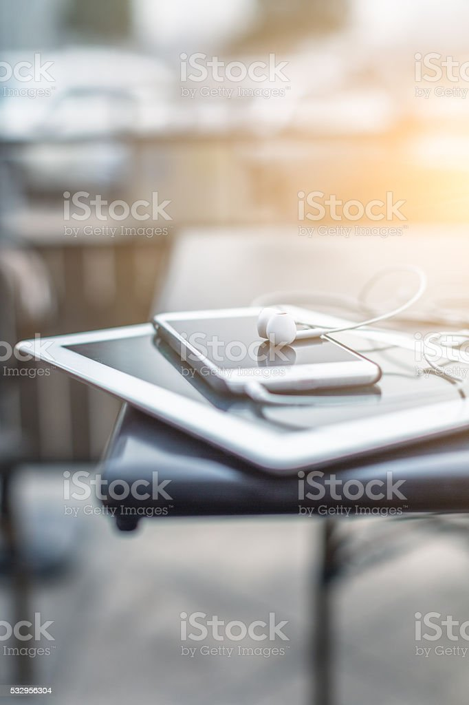 stack of  mobile devices on the cafe table stock photo