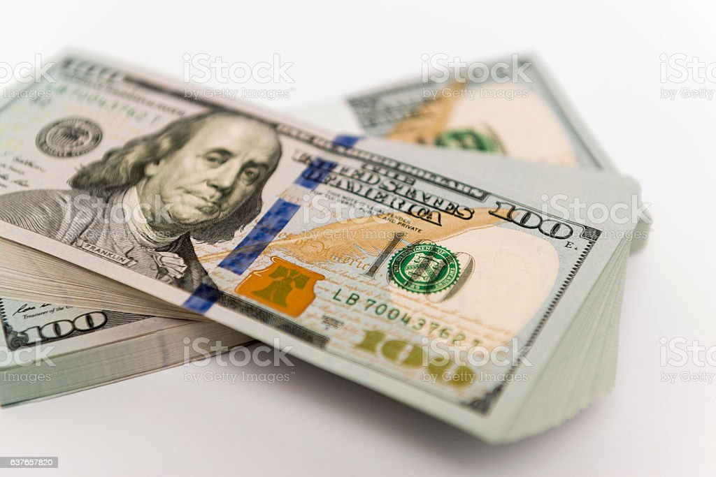 Stack of money in hundred dollar banknotes stock photo
