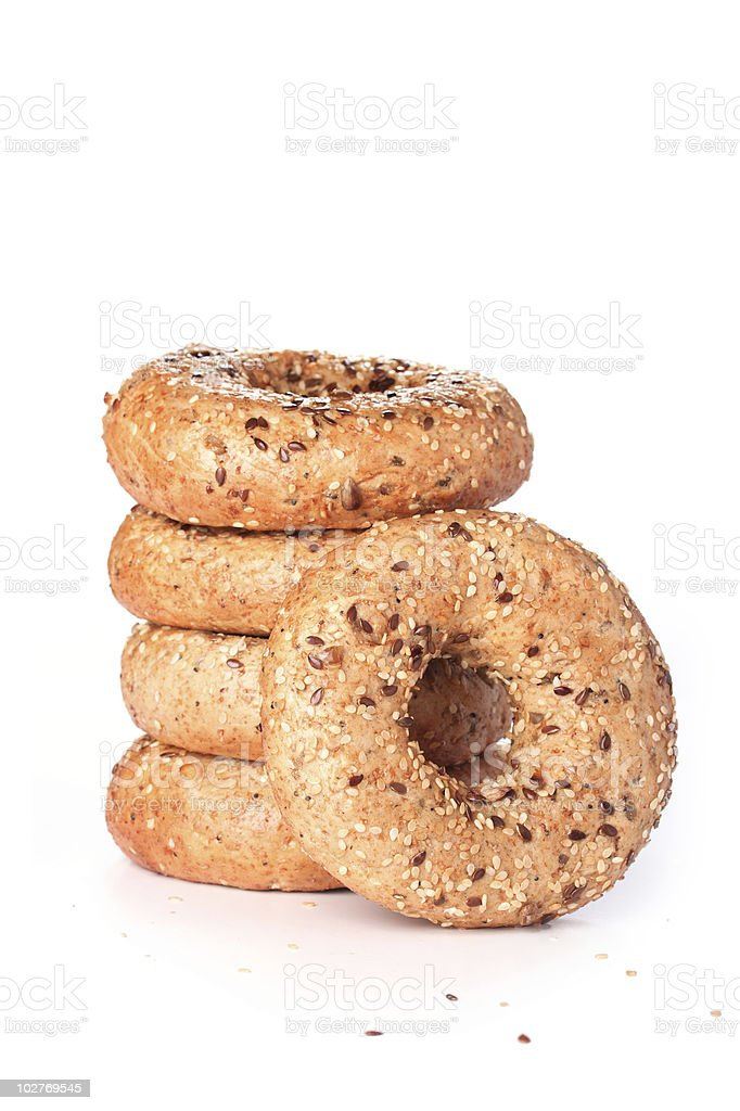 Stack of multi-seeded bagels with focus on front one stock photo