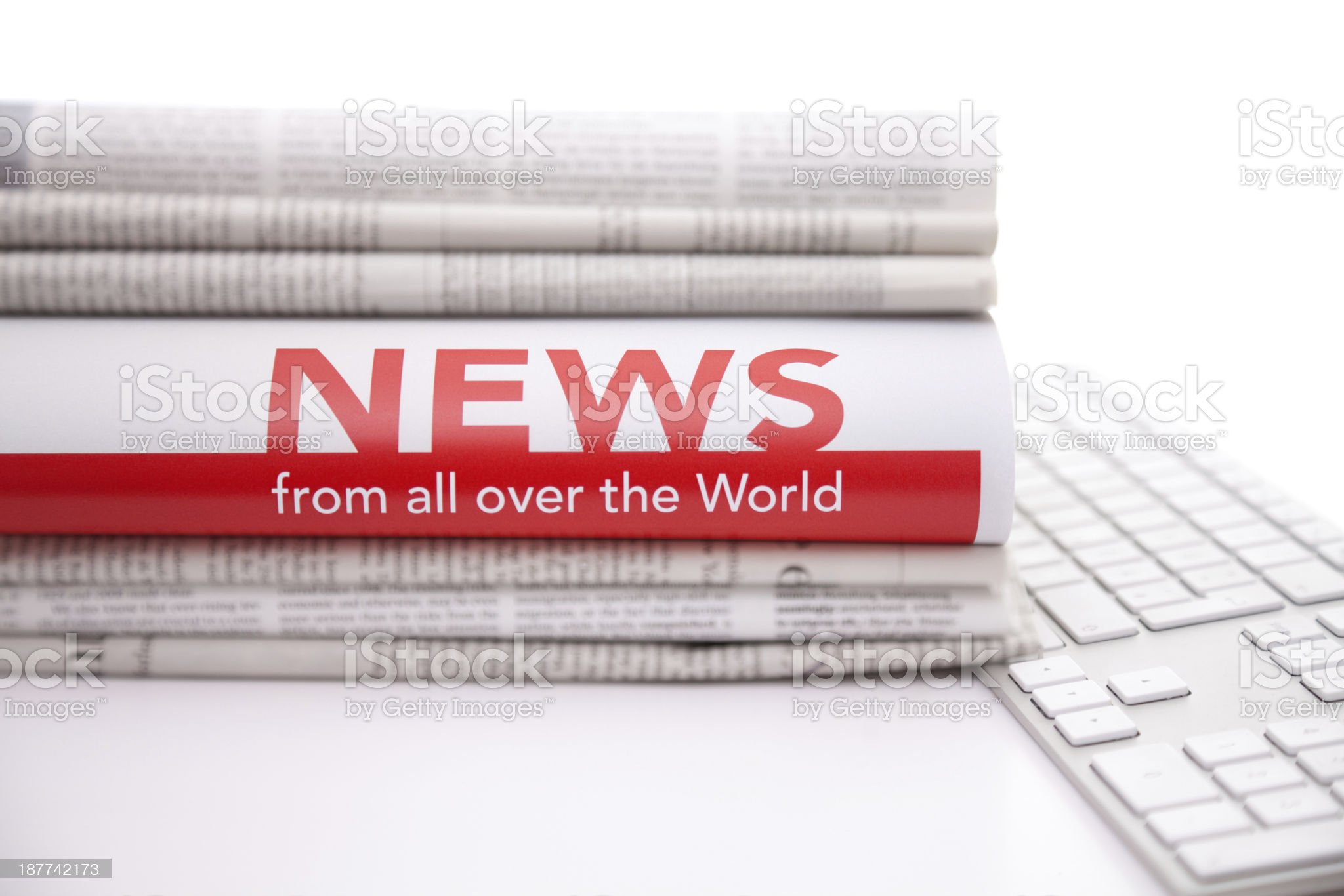 Stack of newspaper on computer keyboard royalty-free stock photo