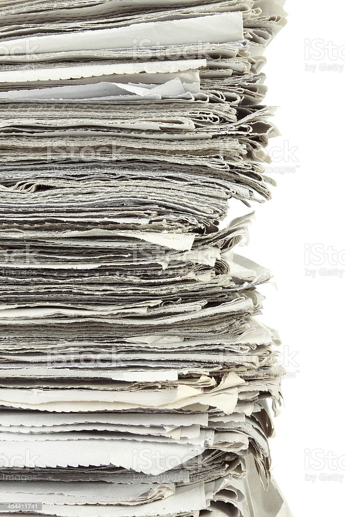 Stack of newspaper on white background royalty-free stock photo