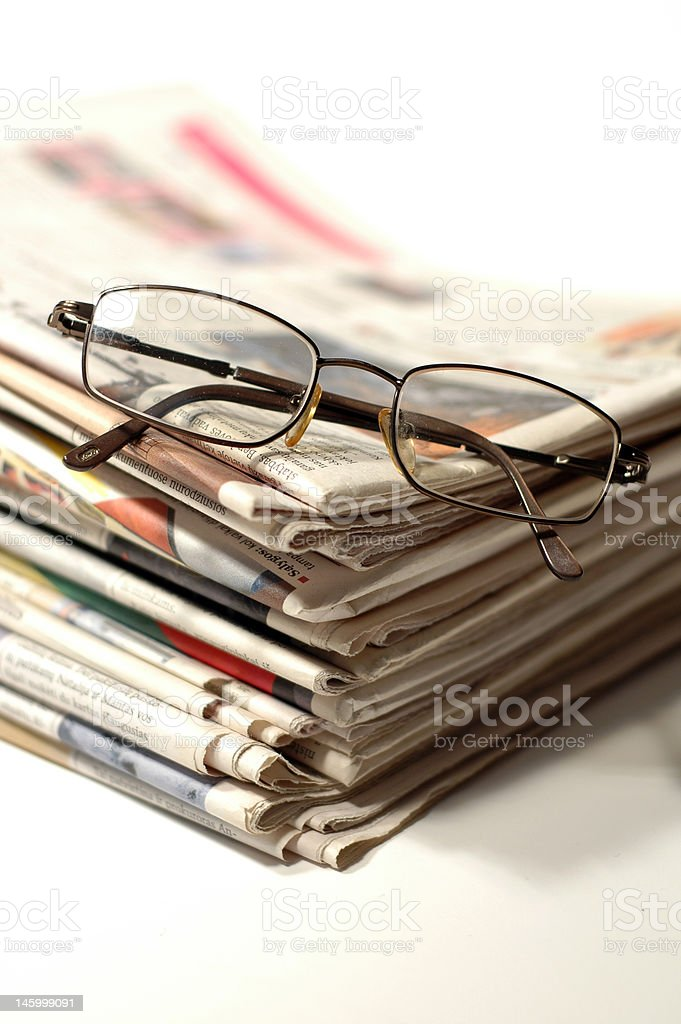 Stack of newspapers and glasses royalty-free stock photo