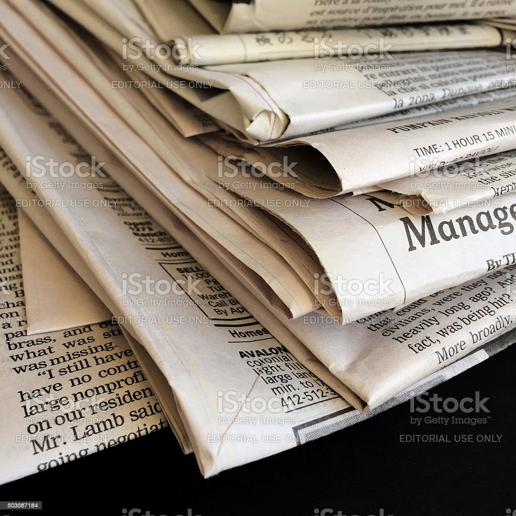 Stack of Newspapers on Black stock photo