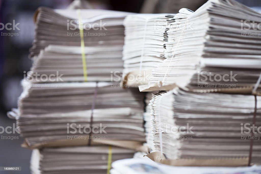 Stack of newspapers on street royalty-free stock photo