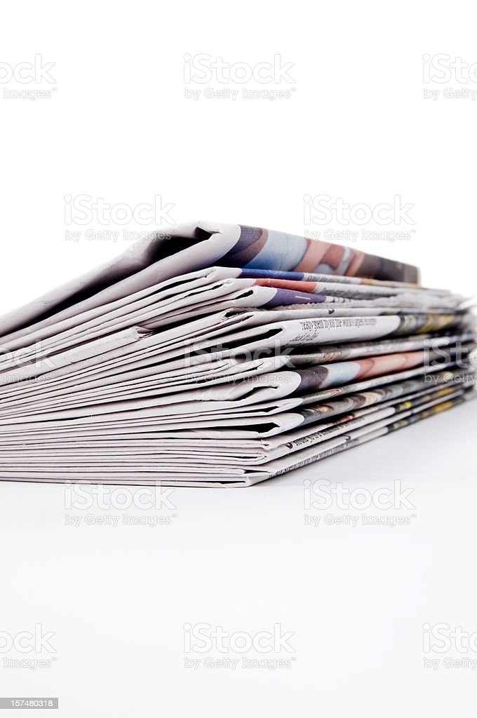 Stack of Newspapers on White royalty-free stock photo