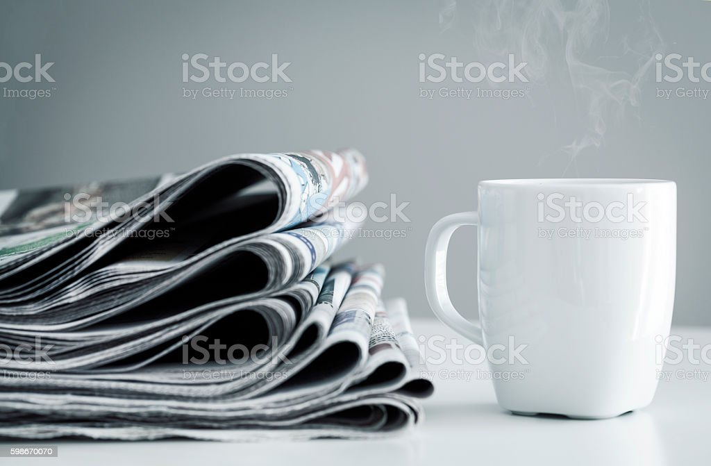 Stack of newspapers stock photo
