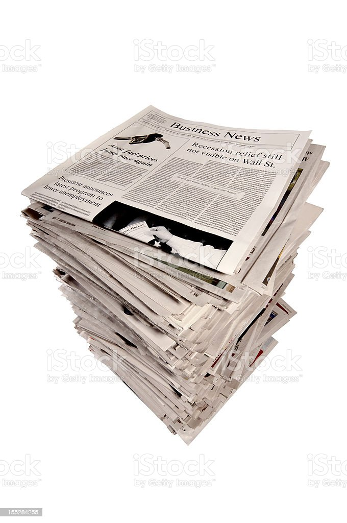 Stack of Newspapers With Business Section On Top royalty-free stock photo