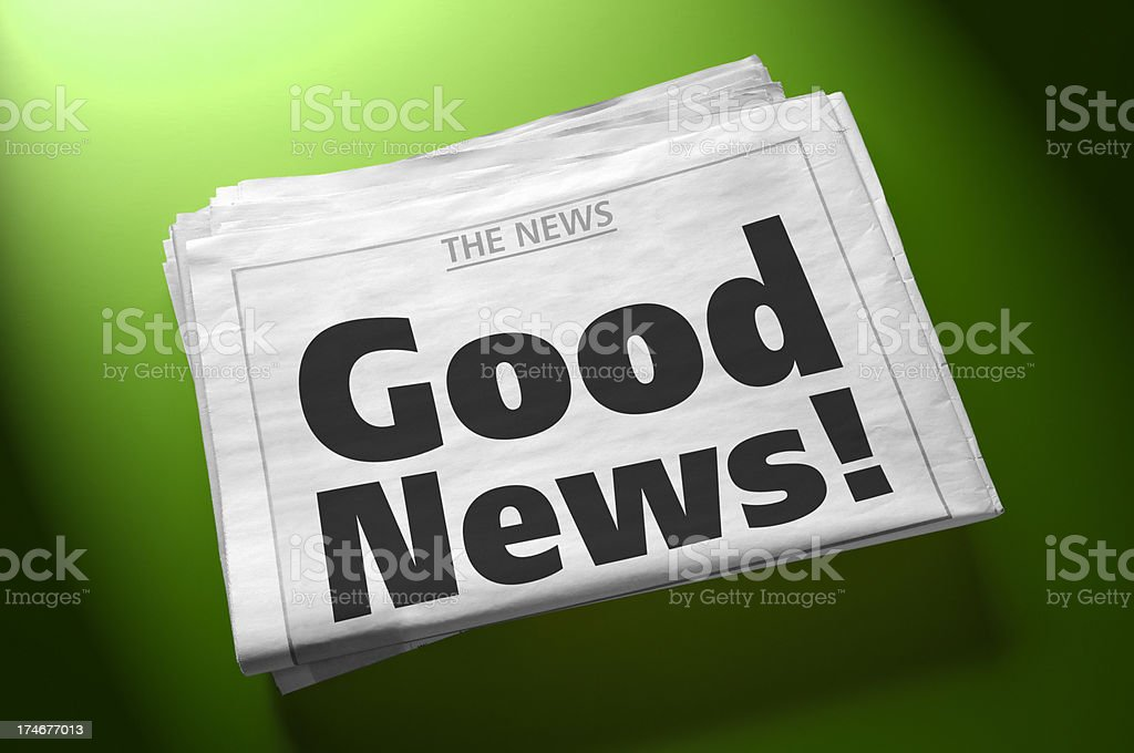 Stack of newspapers with headline Good News! on green background stock photo