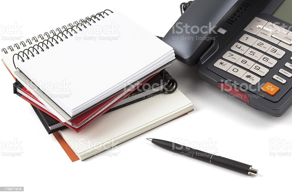 Stack of notebooks and digital phone royalty-free stock photo