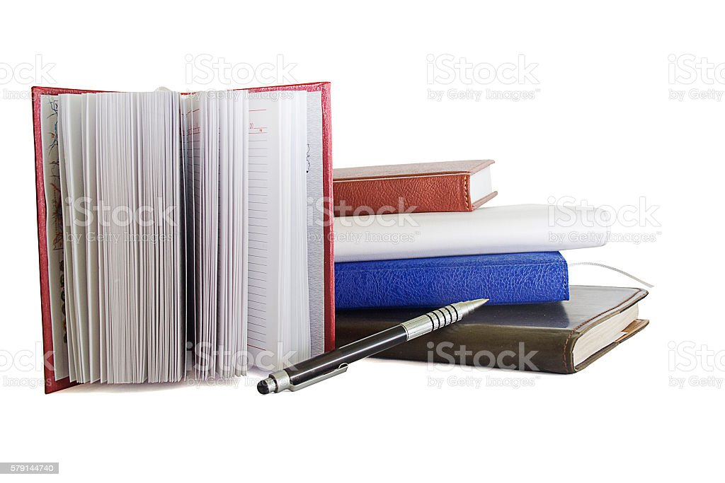 stack of notebooks and pen overwhite stock photo