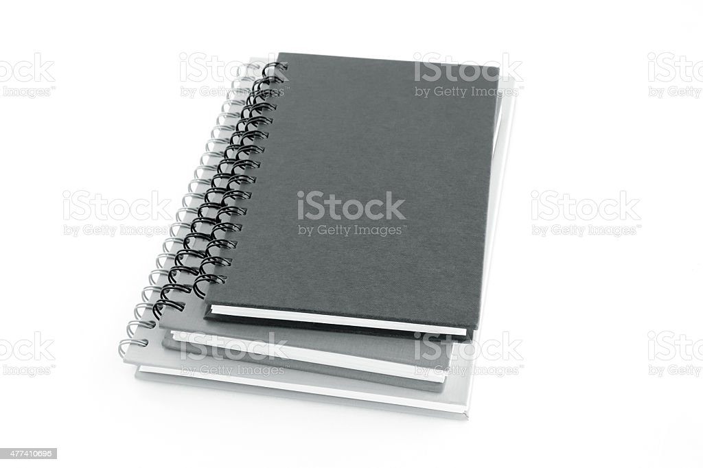 Stack of notebooks or copybooks on white background stock photo
