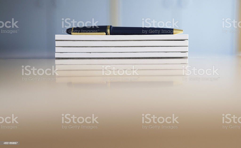 Stack of Notepads and a Pen stock photo