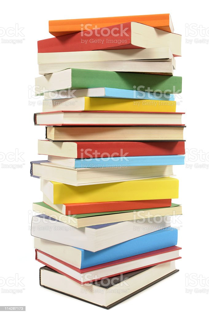 A stack of numerous colorful books royalty-free stock photo