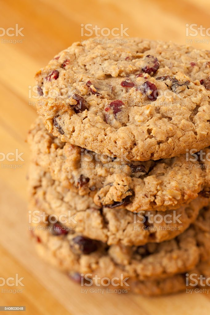 Stack of oatmeal and cranberry cookies stock photo
