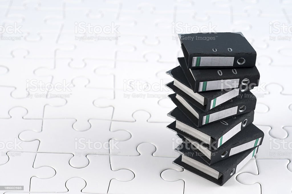 stack of office folders - ring binders on jigsaw pieces royalty-free stock photo