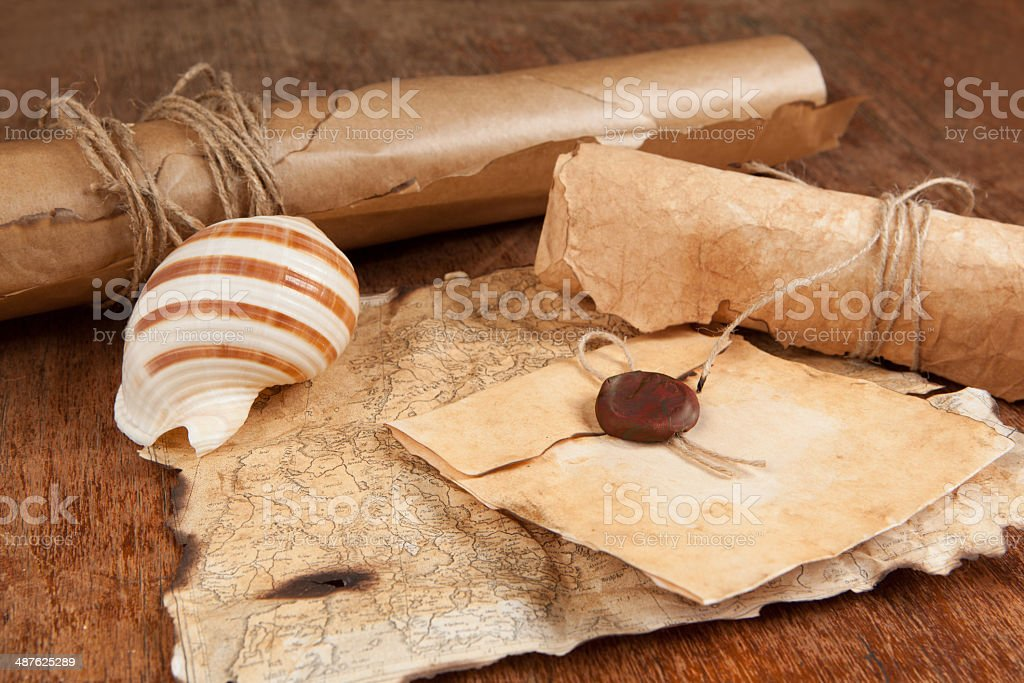 stack of old antique papers and treasure map stock photo