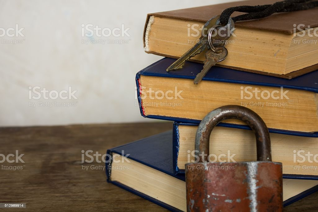 Stack of old big books and lock stock photo