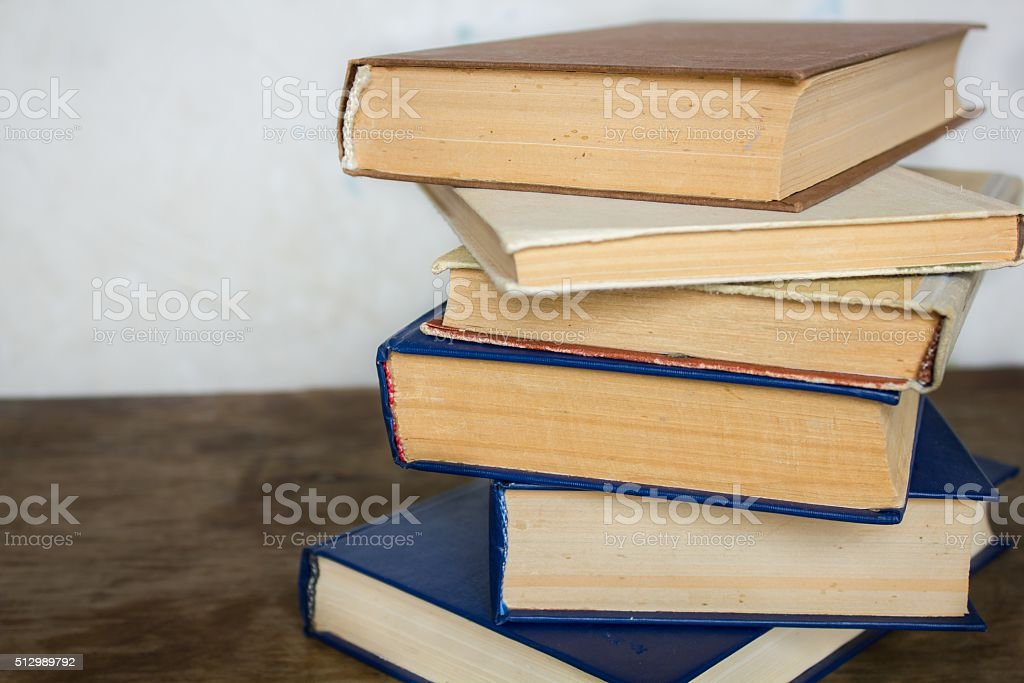 Stack of old big books stock photo
